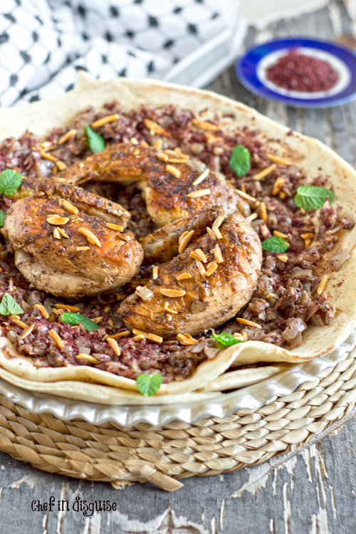 Palestinian musakhan beautiful taboon bread topped with perfectly caramelized onions,seasoned with summac and cardamom.jpg